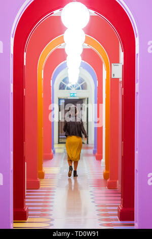 London, UK. 11th June, 2019. The connecting corridor - Get Up, Stand Up Now: Generations of Black Creative Pioneers - a new exhibition at Somerset House celebrating the past 50 years of Black creativity in Britain and beyond. Curated by Zak Ove, it runs 12 June 15 September 2019. Credit: Guy Bell/Alamy Live News - Stock Photo