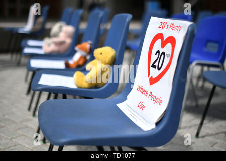 Edinburgh, UK. 11th June, 2019. A coalition of environmental and active travel organisations gather outside the Scottish Parliament ahead of a debate on Mark RuskellÕs 20mph Safer Streets Bill later this week. Pictured  Empty seats representing lost lives. Credit: Steven Scott Taylor/Alamy Live News - Stock Photo