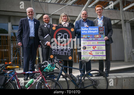 Edinburgh, UK. 11th June, 2019. Green MSPs join a coalition of environmental and active travel organisations outside the Scottish Parliament ahead of a debate on Mark RuskellÕs 20mph Safer Streets Bill later this week. Credit: Steven Scott Taylor/Alamy Live News - Stock Photo