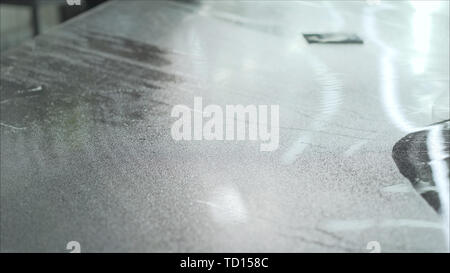 Car wrapping specialist putting vinyl foil or film on car. Detailing wrap auto - Stock Photo