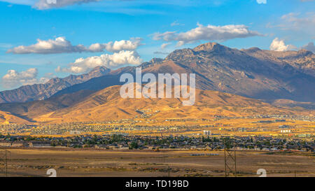 Towering mountains and cloudy sky in Utah Valley - Stock Photo