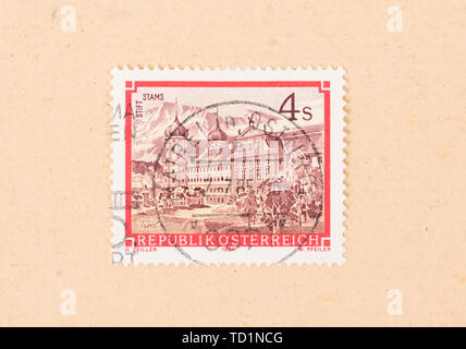 AUSTRIA - CIRCA 1984: A stamp printed in Austria shows Stams abbey, circa 1984 - Stock Photo