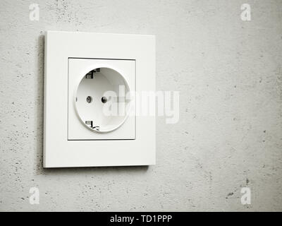 White outlet on the grey wall. 3d rendering illustration - Stock Photo