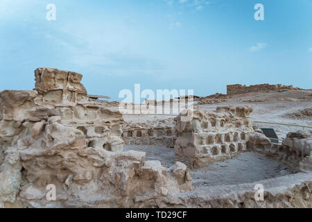 Ruins of Herods castle in fortress Masada, Israel. Ancient ruins of fortification built on the plateau on mountain overlooking the Dead Sea. Famous - Stock Photo