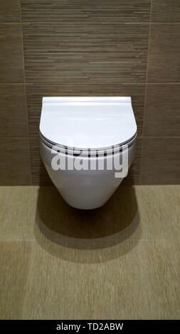 Mounted toilet bowl. Closed Toilet in the toilet - Stock Photo