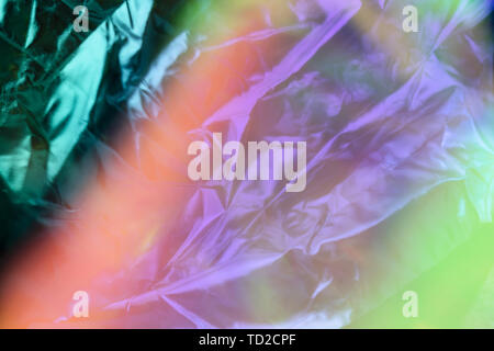 Modern beautiful holographic background of blurred crumpled foil. Trendy 80's style. Wallpaper design. - Stock Photo