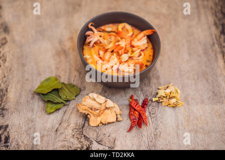 Prawn and lemon grass soup with mushrooms,Tom Yam Kung ,thai food in wooden background, top view - Stock Photo