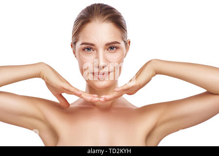 I want to be perfect! Portrait of young smiling woman with lifting arrows over her face isolated on white background. Face Lifting. Anti aging treatme - Stock Photo