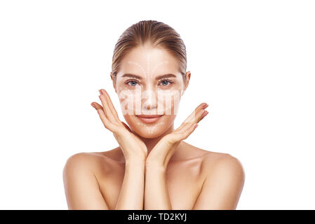 Face Lifting. Portrait of gorgeous and young woman with fresh clean skin and lifting arrows over her face. Isolated on white background. Cosmetic Medi - Stock Photo