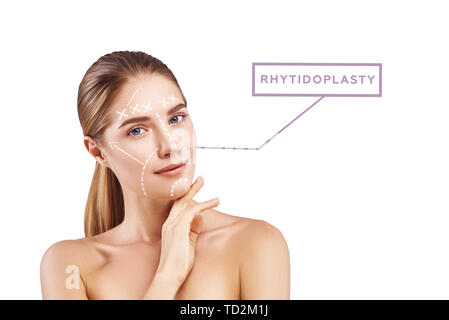 Anti-aging procedures. Portrait of attractive young woman with perfect skin and graphic lines and arrows over her face isolated on white background. Rhytidoplasty concept. Lifting skin concept - Stock Photo
