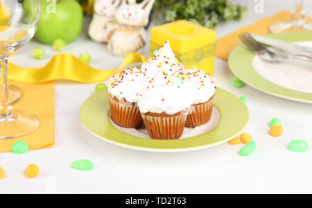 Easter cupcakes on Easter table close-up - Stock Photo