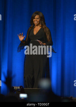 Former U.S.A First Lady Michelle Obama attends An Intimate Conversation about her book 'Becoming:  with Michelle Obama', featuring moderator Michele Norris at BB&T Center on May 10, 2019 in Sunrise, Florida.  Featuring: Michelle Obama Where: SUNRISE, Florida, United States When: 11 May 2019 Credit: Johnny Louis/WENN.com - Stock Photo