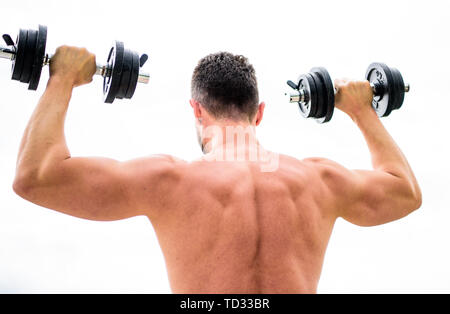 Muscular man exercising with dumbbell rear view. Actions speak louder than coaches. Sportsman with strong back and arms. Sport equipment. Bodybuilding sport. Sport lifestyle. Dumbbell exercise gym. - Stock Photo