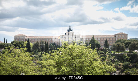 Toledo, Spain - April 28, 2018: All for the homeland, Spanish Infantry Academy. Architectural detail of the Spanish army infantry academy near the his - Stock Photo