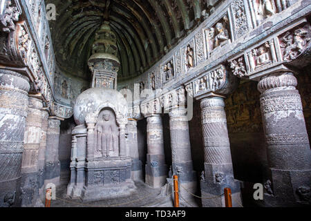 Stupa carved with a standing lord Buddha image, Cave 19 (5th century CE), Ajanta Caves, Aurangabad District, Maharashtra State, India - Stock Photo