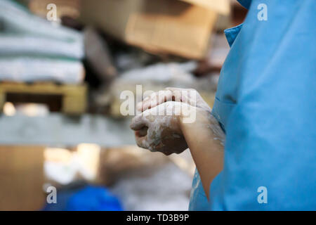 young woman came to study pottery and ceramics. Hands in white clay. training, reportage. - Stock Photo