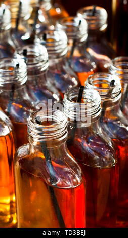 Creative bottle set of alcohol cocktails in bar - Stock Photo