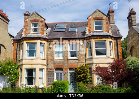 Classic period Victorian semi detached two houses with garden in front - Stock Photo