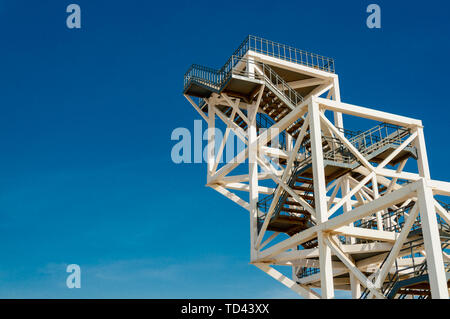 White metal frame viewing platform on the rann of kutchh against blue sky - Stock Photo