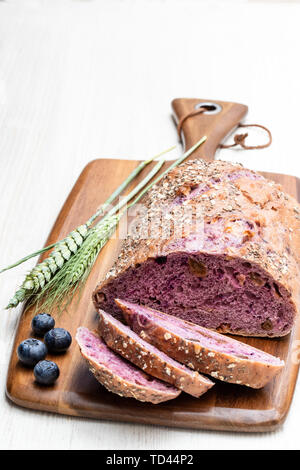 Blueberry  and chia seed bloomer isolated on white - Stock Photo