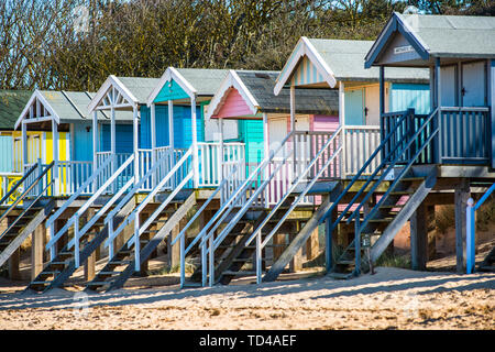 Colourful beach huts on Wells beach at Wells next the Sea on North Norfolk coast, Norfolk, East Anglia, England, United Kingdom, Europe - Stock Photo