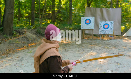 Male archer with wooden bow - Stock Photo