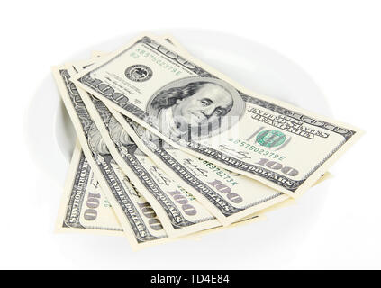 Money on plate isolated on white - Stock Photo