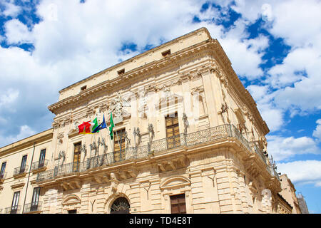 Detail of beautiful Vermexio Palace in Syracuse, Sicily, Italy. The historical building serves nowadays as a town hall. Located on famous Ortygia Island close to Syracuse Cathedral. Popular site. - Stock Photo