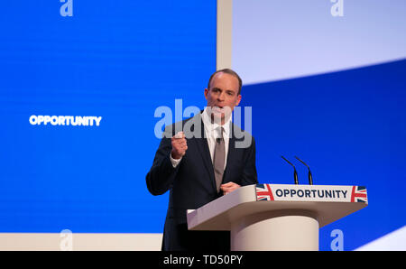 London, UK. 10th June, 2019. File photo taken on Oct. 1, 2018 shows former British Brexit secretary Dominic Raab delivering a speech during the Conservative Party annual conference 2018 in Birmingham, Britain. The race to choose a new prime minister officially started on June 10, 2019 with ten hopefuls bidding to win the biggest job in British politics. Credit: Han Yan/Xinhua/Alamy Live News - Stock Photo