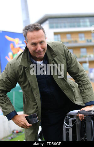 Taunton, UK. 12th June, 2019. Former England cricket team captain and broadcaster Michael Vaughan struggles over the advertising boards during the Australia v Pakistan, ICC Cricket World Cup match. at the County Ground, Taunton. Credit: European Sports Photographic Agency/Alamy Live News - Stock Photo