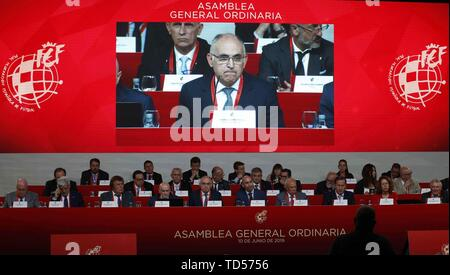Madrid, Spain. 12th June, 2019. President of the Royal Spanish Soccer Federation (RFEF) Luis Rubiales (R) and IOC President Thomas Bach (L) take part in the General Ordinary Assembly of the federation, in Madrid, Spain, 12 June 2019. The RFEF will contact cities willing to host the 2030 World Cup along Portugal. Credit: Paco Campos/EFE/Alamy Live News - Stock Photo