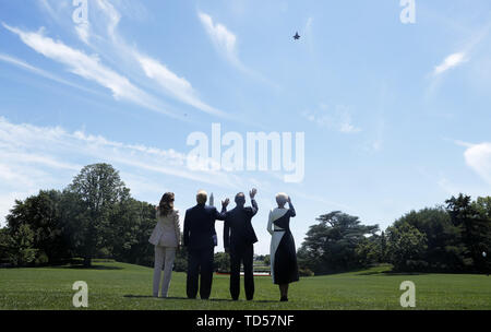 June 12, 2019 - Washington DC, U.S. - (L-R) US First Lady Melania Trump, US President Donald J. Trump, Polish President Andrzej Duda and Polish First Lady Agata Kornhauser-Duda watch a flyover by US Lockheed Martin F35 planes from the South Lawn after particvipating in a signing ceremony in the Diplomatic Reception Room of the White House in Washington, DC, USA, 12 June 2019. President Trump and President Duda signed an agreement to increase military to military cooperation including the purchase of F-35 fighter jets by Poland and an increased US troop presence in Poland. C - Stock Photo