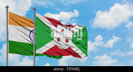 India and Burundi flag waving in the wind against white cloudy blue sky together. Diplomacy concept, international relations. - Stock Photo