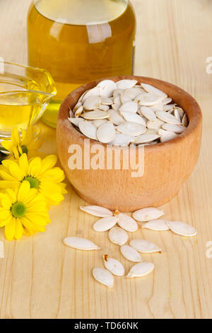 Useful pumpkin seed oil on wooden table close-up - Stock Photo