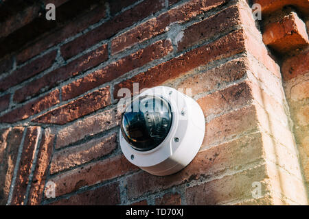 Barcelona, Spain - Nov 14, 2017: Axis 360 degrees surveillance camera on brick wall. Axis Communications AB is a Swedish manufacturer of network camer - Stock Photo