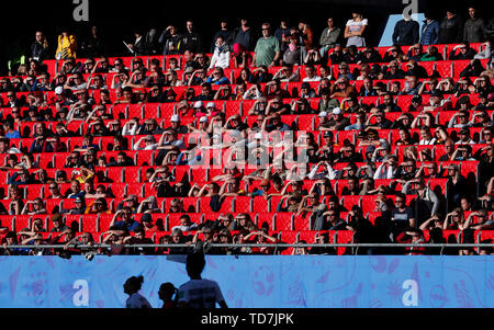 Valenciennes, France. 12th June, 2019. Fans watch the Group B match between Germany and Spain at the 2019 FIFA Women's World Cup in Valenciennes, France, June 12, 2019. Germany won 1-0. Credit: Zheng Huansong/Xinhua/Alamy Live News - Stock Photo