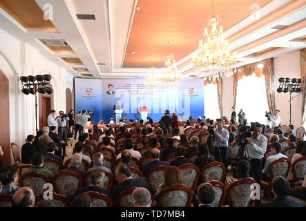 (190613) -- DUSHANBE, June 13, 2019 (Xinhua) -- The Tajik edition of the first volume of 'Xi Jinping: The Governance of China' is released at a China-Tajikistan seminar on state governing, prior to the state visit of the Chinese president to the Central Asian country, in Dushanbe, capital of Tajikistan, June 11, 2019. Tajik President Emomali Rahmon congratulated his Chinese counterpart on the publication of the book in a letter, which was read by First Deputy Prime Minister Davlatali Said at the event. (Xinhua/Sadat) - Stock Photo