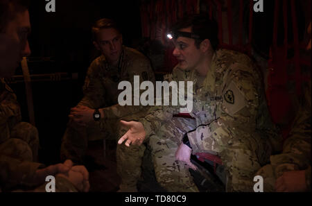Dahlke, Afghanistan. 22nd Oct, 2018. Chief Warrant Officer 3 Chnaibly briefs his crew before a mission to drop both US and Afghan Special Forces in the mountains. FOB(forward operating base) Dahlke is a new austere US Army base, as of Spring 2018, in Afghanistan that began with a large presence of soldiers from the 101st Combat Aviation Brigade. Dahlke is strategically located about 60 miles South of Kabul. Every type of air support mission is done from here, from medevac to resupply to combat. Dahlke was built from the ground up over the past year by the soldiers stationed here. It is b - Stock Photo