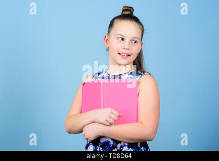 Keeping her secrets in diary. Child cute girl hold notepad or diary blue background. Childhood memories. Note secrets down in cute girly diary journal. Diary for girls concept. Keeping secrets here. - Stock Photo