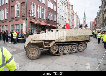 Reconstruction of WWII German Sd.Kfz. 251 armored car during Victory Parade in Gdansk, Poland. May 11th 2019. In the early days of the Warsaw Uprising - Stock Photo