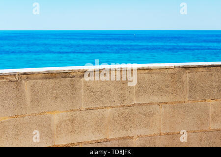 Blurred Mediterranean Sea view behind the Parque de la Bateria observation tower wall at Torremolinos, Province of Malaga, Andalusia, Spain - Stock Photo