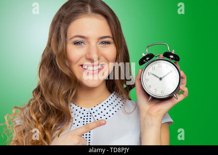 young woman holding a clock. time management concept - Stock Photo