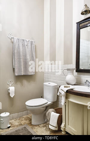 Soap on white towel and ceramic jug next to wash basin in stand in traditional bathroom   UK & IRISH USE ONLY - Stock Photo