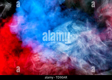 Dense multicolored smoke of red, purple and pink colors on a black isolated background. Background of smoke vape - Stock Photo