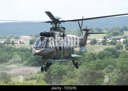The Bulgarian Chief of Defense General Andrey Botsev arrives by Eurocopter AS532 Cougar helicopter during STRIKE BACK 19 at Novo Selo Training Area, Bulgaria, June 12, 2019. STRIKE BACK 19 is a multinational exercise hosted by the Bulgarian Land Forces from June 6-20, 2019. STRIKE BACK 19 is designed to increase capabilities and interoperability with Bulgarian, Albanian, Greek, North Macedonian and U.S. Troops. (U.S. Army photo by Spc. Abigail Graham) - Stock Photo