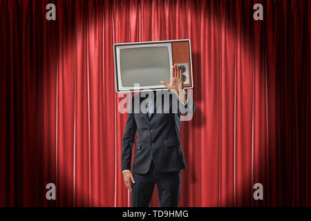 Businessman with vintage tv set instead of head making stop gesture on red stage curtains background. Vintage vehicles. Technologies and communication - Stock Photo