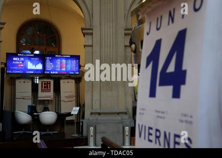 Madrid, Spain. 14th June, 2019. A screen shows the evolution of the markets at the stock market in Madrid, Spain, 14 June 2019. Spanish index IBEX 35 dropped a 0.22 per cent at the start of the trading day as the market keeps an eye on the trade war between US and China and the geopolitical crisis in the Persian Gulf. Credit: Juan Carlos Hidalgo/EFE/Alamy Live News - Stock Photo