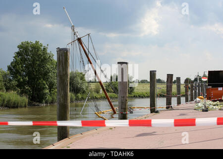 Stadersand, Germany. 14th June, 2019. The sunken historical sailing ship 'No 5 Elbe' lies in the harbour of Stadersand in a closed off area. Salvage preparations are underway. The historic sailing ship, which has only recently been extensively renovated, collided with a container ship on the Elbe and sank. Credit: Bodo Marks/dpa/Alamy Live News - Stock Photo