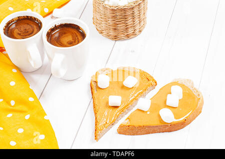 Peanut butter sandwiches. Healthy breakfast, coffee and bread with peanut butter - Stock Photo
