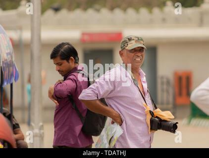 Bangalore, Karnataka India-June 04 2019: Photographer at Vidhana soudha waiting for customers or people to taking pictures - Stock Photo